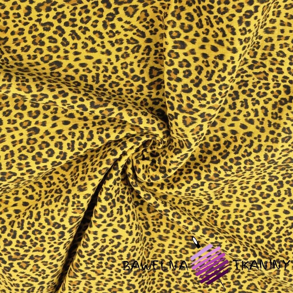 Cotton muslin double gauze with panther pattern on a mustard background