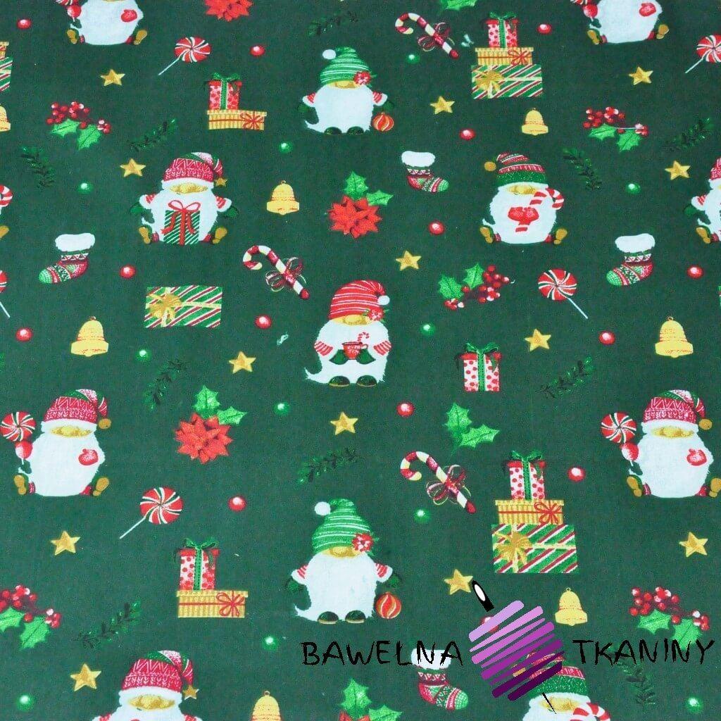 Bawełna wzór świąteczny mikołaje z prezentami na ciemno zielonym tle