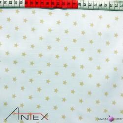 Bawełna małe Gwiazdki beżowe białe tło