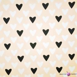 Bawełna biało czarne serca na morelowym tle