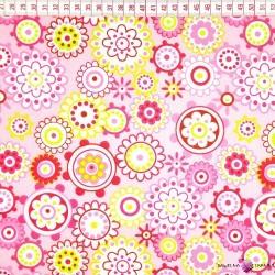 Bawełna kolorowe kwiaty w kołach na różowym tle