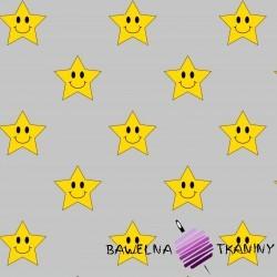 Bawełna uśmiechnięte żółte gwiazdki na szarym tle
