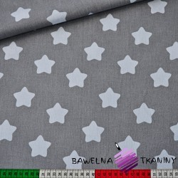 Cotton white gingerbread stars on gray background