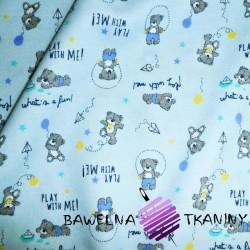 Knitwear teddy bears on light blue background