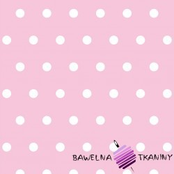 Cotton white spots on pink background