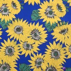 Waterproof fabric sunflowers on green background