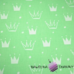Cotton white crowns with dots on green background