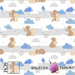 Cotton beige teddy bears with a blue kite on a white background