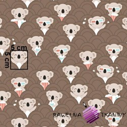 Cotton koala in the cinema on a brown background