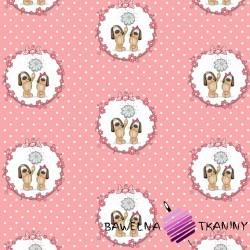 Bawełna pieski w kołach na różowym tle w grochy