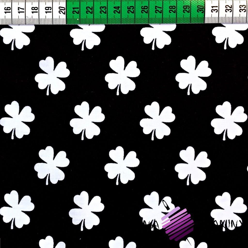Bawełna koniczyna biała na czarnym tle