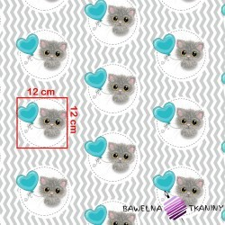 Cotton kitten with a turquoise balloon on a white-gray zigzag background