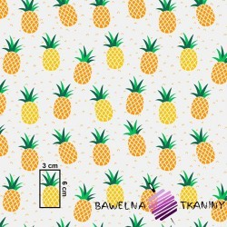 Cotton yellow-orange pineapples on a gray background