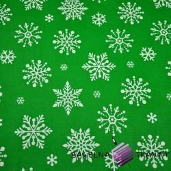 Cotton big white snowflake on green background
