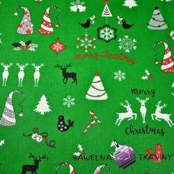 wzór świąteczny renifery i choinki na zielonym tle