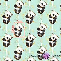 Cotton shiny gold panda with bamboo on a mint background