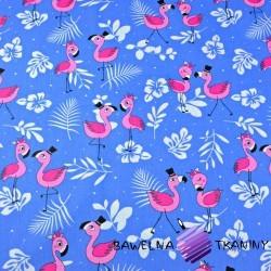 Bawełna flamingi różowe z listkami na niebieskim tle