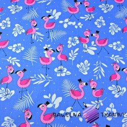 Cotton pink flamingos with leaves on a blue background