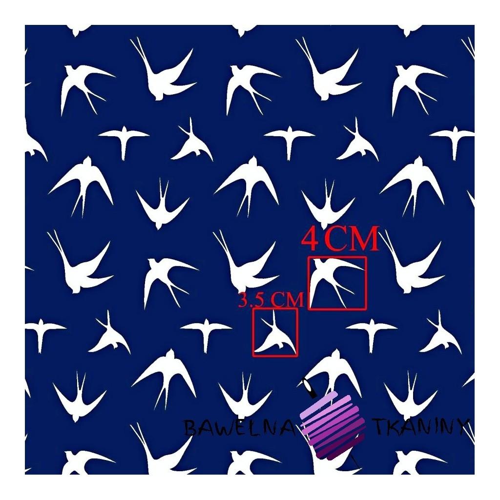 Cotton white swallows on a navy background