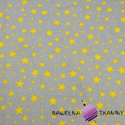Bawełna gwiazdki nowe małe i duże żółte na szarym