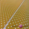 Cotton white dots mustard background