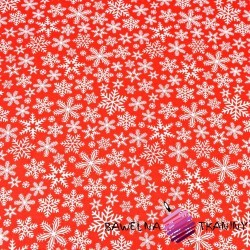 Cotton white snowflakes on red background