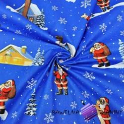 wzór świąteczny mikołaje z domkami na niebieskim tle