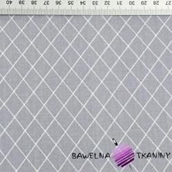 romby białe na szarym tle